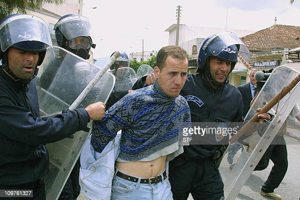 An Algerian youth is arrested by security forces in Tizi Ouzou 140 km south of Algiers 28 April 2001 Renewed riots broke out today in Algeria's...
