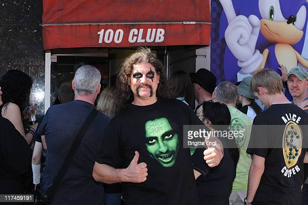 An Alice Cooper Fan waits for Alice Cooper to perform on stage at The 100 Club on June 26 2011 in London United Kingdom