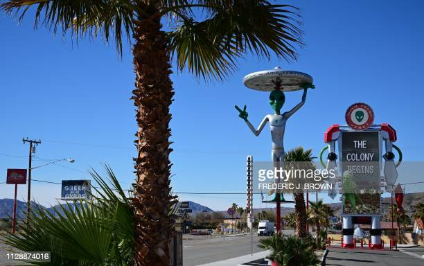 An Alien sculpture lines the side of the road in the town of Baker, California, which claims the world's largest thermometer at 134 feet, and it also...