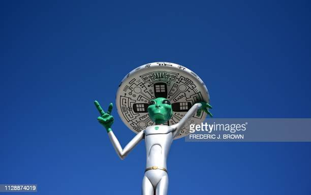 An Alien sculpture lines the side of the road in the town of Baker California which claims the world's largest thermometer at 134 feet and it also...