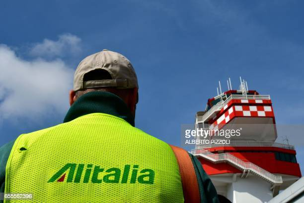 An Alitalia air transport employee takes part in a protest rally on March 20 2017 at Rome's Fiumicino airport Air traffic in Italy was being...