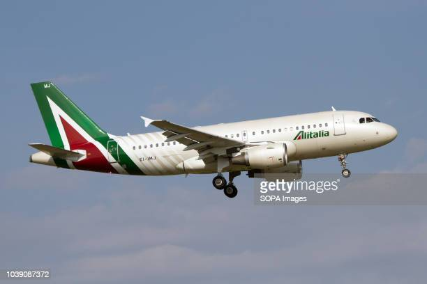 An Alitalia Airbus 319 seen in new livery landing at Rome Fiumicino airport
