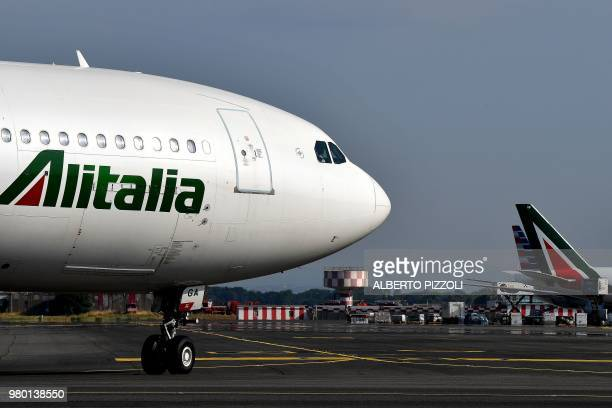 An Alitalia airplane is seen rolling on the tarmac on June 21 2018 at the Fiumicino Airport in Rome