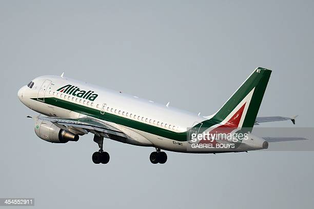 An Alitalia airplane takes off on December 9 2013 at the Fiumicino airport near Rome Italian businessman Antonio Percassi said on December 7 2013 he...