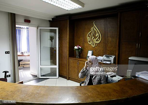 An AlJazeera employee talks on the phone at the panArab television channel's bureau in Cairo on January 30 2011 Egypt has ordered a shutdown of...