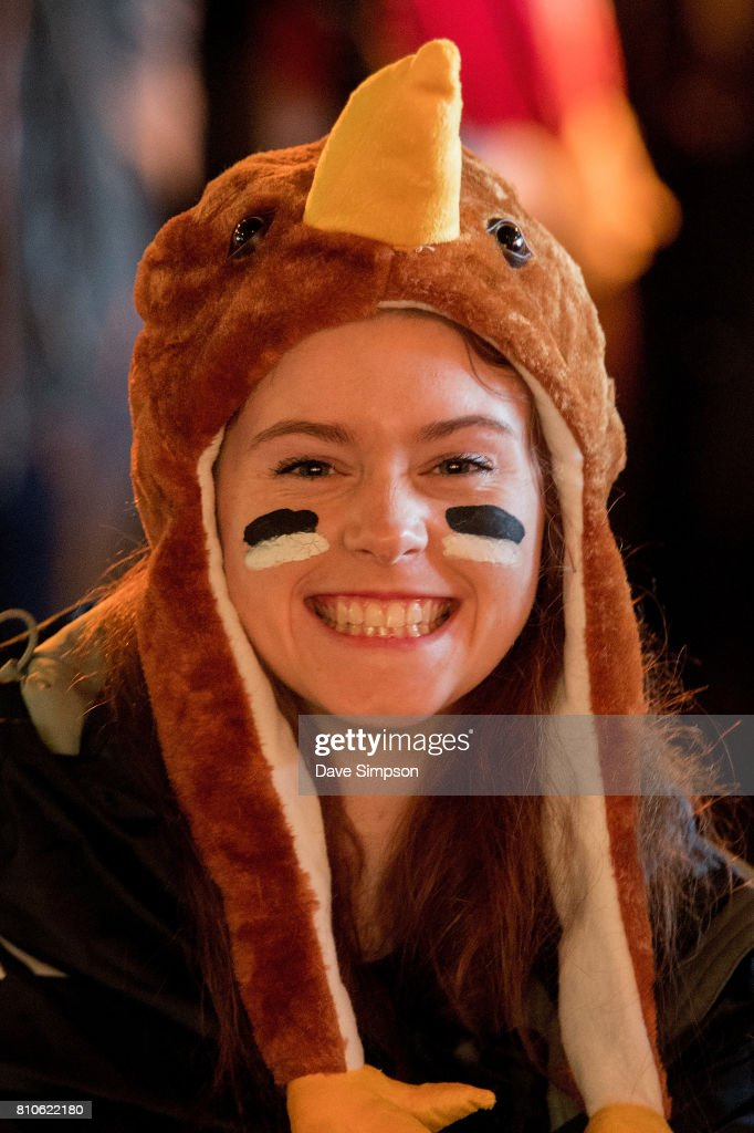 An All Blacks fan wearing a hat depicting a kiwi bird poses ahead of the Rugby Test match between the New Zealand All Blacks and the British & Irish Lions at Auckland's Queens Wharf Fanzone on July 8, 2017 in Auckland, New Zealand.