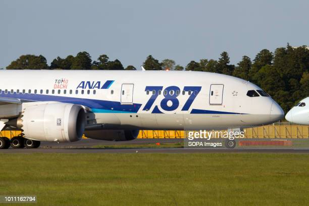 An All Nippon Airways Boeing 7878 dreamliner with a Tomo Dachi sticker lining up at Tokyo Narita airport