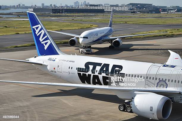 An All Nippon Airways Boeing 7879 aircraft with a Star Wars logo seen on the tarmac at Tokyo's Haneda airport on October 14 as part of the company's...