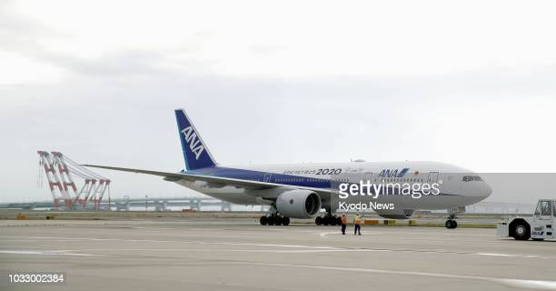 An All Nippon Airways Co plane prepares to take off from Kansai International Airport which sits on a manmade island in Osaka Bay on Sept 14 as...