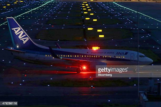 An All Nippon Airways Corp aircraft taxies at night at the Kansai International Airport in Izumisano City Osaka Japan on Sunday June 28 2015 Staterun...