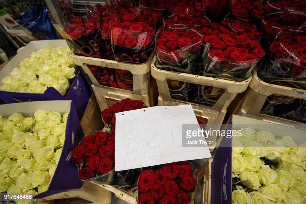 An 'All Sold' sign sits on top of bunches of roses at New Covent Garden Flower Market ahead of Valentine's Day on February 13 2018 in London England...