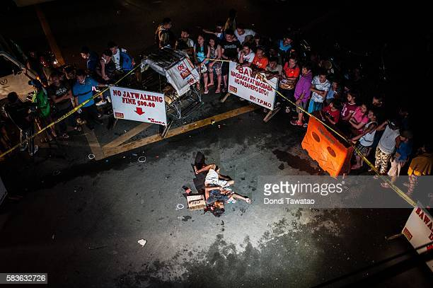 An alleged drug dealer and victim of a summary execution lies dead on a main throughfare on July 23 2016 in Manila Philippines The victim was an...
