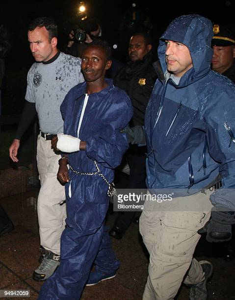 An alleged Somali pirate identified by authorities as Abduwali Muse is walked into FBI headquarters in New York US on Monday April 20 2009 An alleged...