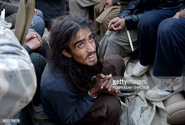 An alleged Taliban militant sits handcuffed while being presented to the media in Jalalabad Nangarhar province of Jalalabad on December 29 2015...
