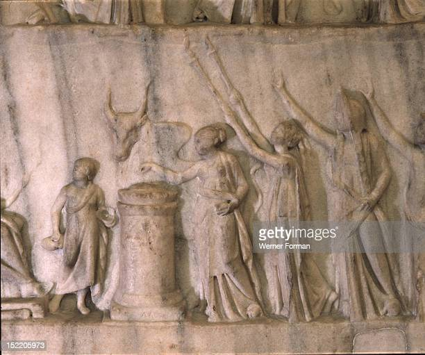 An allegorical representation of The Apotheosis of Homer signed by a sculptor from Priene a Greek town in Asia Minor Shows allegorical figures One is...