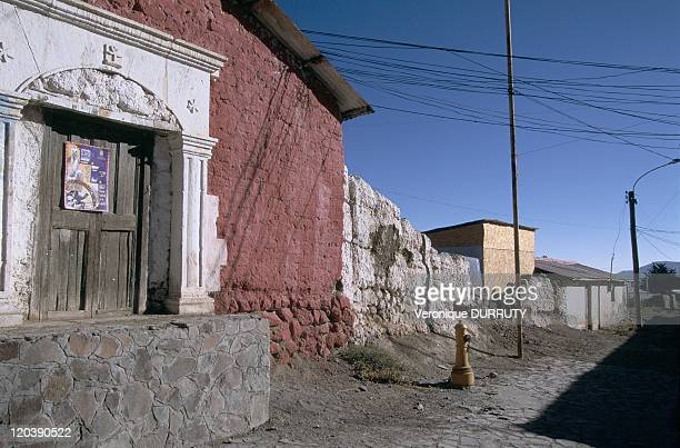 An alley in a Indian village of the Haures Andes near Africa in Arica Chile