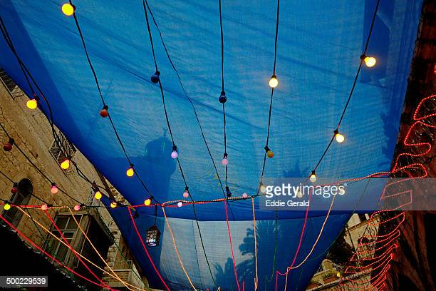 An alley in the Muslim Quarter decorated with festive lights during the Muslim holy month of Ramadan in the old city East Jerusalem Israel