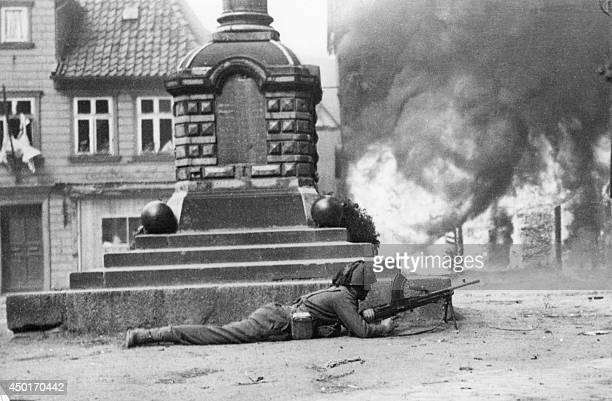 An Allied soldier with a machinegun surveys a crossroads of a partially occupied German village in April 1945 by the end of World War II AFP PHOTO