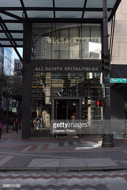 An AllSaints store front and signs in downtown Seattle Washington Pedestrians are seen outside this international clothing chain