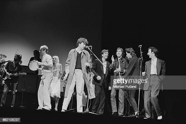 An allstar lineup performs 'I Shall Be Released' at the finale of 'The Secret Policeman's Other Ball' at the Drury Lane theatre London 9th September...