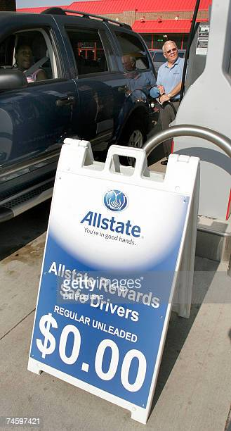 An Allstate employee filsl the tank of a car during a free gas promotion at a gas staion June 14 2007 Warren Michigan Hundreds of motorists lined up...