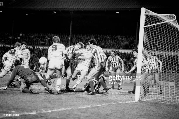 An almighty scramble in the Sheffield Wednesday goalmouth as Chelsea's David Speedie Mickey Thomas Kerry Dixon and Colin Lee try to force the ball...
