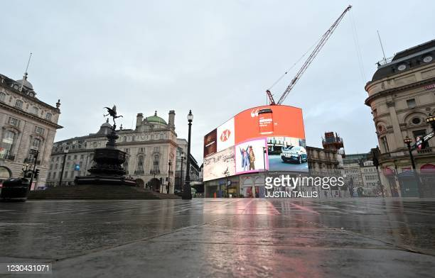 An almost deserted Piccadilly Circus is pictured as Britain enters a national lockdown in London on January 5, 2021. - England's six-week lockdown,...