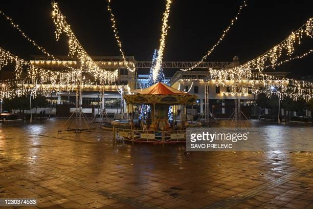 An almost deserted Podgorica's central square is seen on New Year's Eve on December 31 as gatherings and celebrations have been restricted amid...