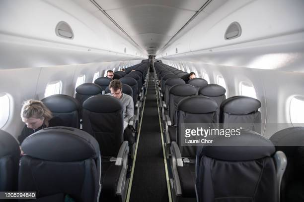 An almost empty British Airways passenger plane flies from Milan to London on March 5, 2020 in Milan, Italy. Confturismo-Confcommercio, a business...