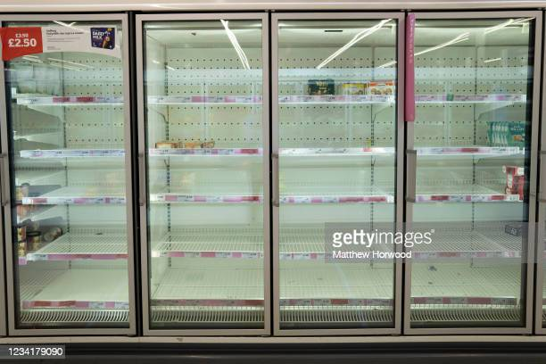 An almost empty freezer at a Sainsbury's store on July 25, 2021 in Cardiff, United Kingdom. Supermarkets across the UK are emptying of fresh produce...