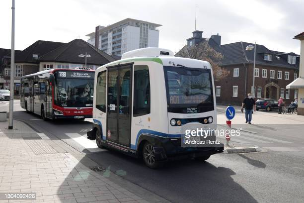 An almost fully autonomous electric mini bus, without a driver, drives through the streets on the two-kilometer route between the bus station and the...