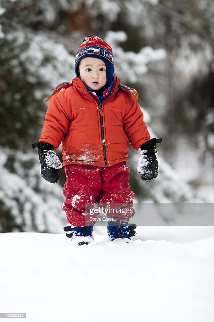 A Small Boy With Blond Hair Of Two Years Old Climbs On