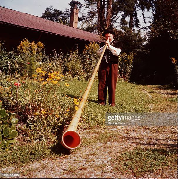 An alp horn or alpenhorn a wood wind instrument used in the Swiss Alps