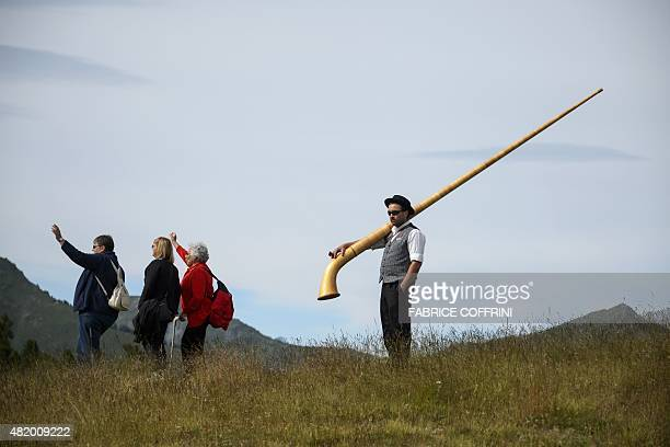 An Alphorn blower attends the final day of the 14th International Alphorn contest on the mountain pasture of Tracouet above Nendaz in the southern...