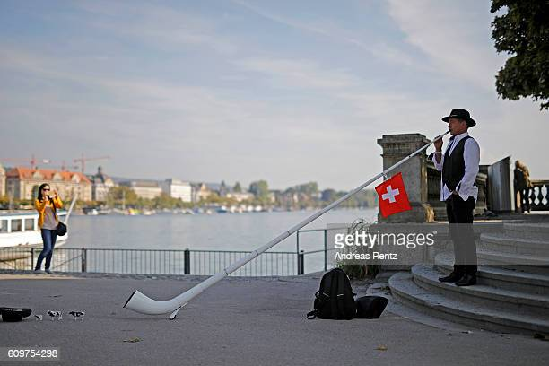 An alphorn blower is seen on the streets during the 12th Zurich Film Festival on September 22 2016 in Zurich Switzerland The Zurich Film Festival...