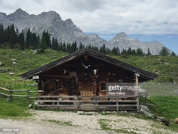 An alpine hut called an alm used by cattle herders stands in the Karwendel mountain range on August 8 2015 near Herrenhaeuser Austria The Karwendel...