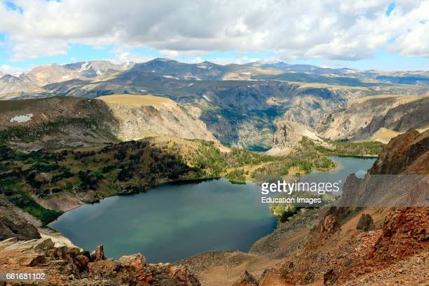 An alpine lake slips into afternoon shadows in the Bear tooth Mountains of the Shoshone National Forest in far northern Wyoming The Bear tooth...