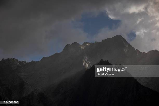 An alpine storm brings rain and lightning to the High Sierra Nevada mountains, which are devoid of the snow packs that normally last throughout the...