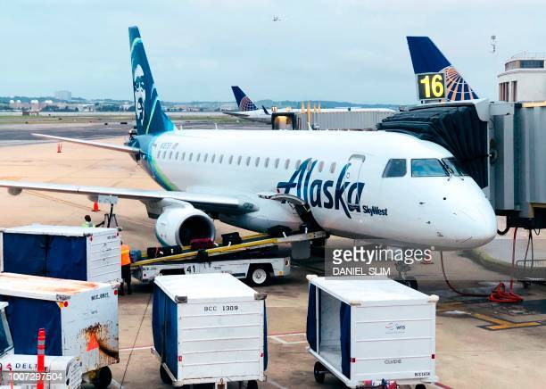 An Alskan airlines plane is seen at the gate at Regan International Airport in Arlington Virginia on July 25 2018