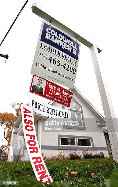 An also for rent sign hangs from a for sale sign in the yard of a home in Park Ridge, Illinois, U.S., on Thursday, Nov. 6, 2008.