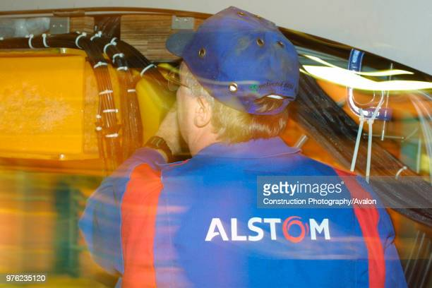 An Alstom employee is seen here helping to assemble a Virgin Trains Pendolino at Alstom's Train Assembley depot at Washwood Heath Birmingham UK 2002