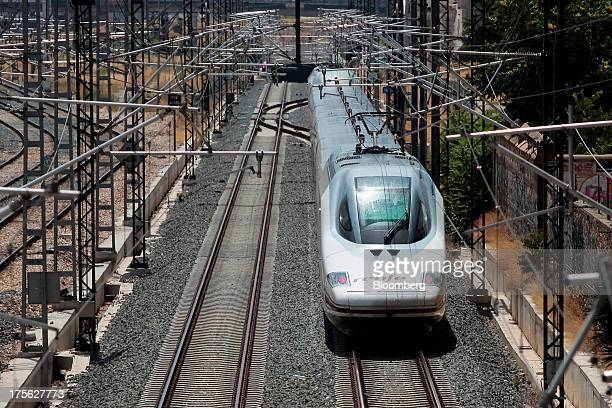 An Alta Velocidad Espanola highspeed train operated by Renfe Operadora SC arrives at Joaquin Sorolla train station in Valencia Spain on Saturday Aug...