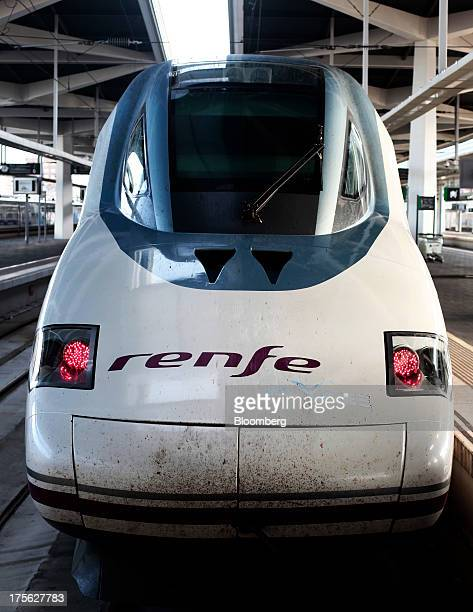 An Alta Velocidad Espanola highspeed train operated by Renfe Operadora SC sits alongside a platform at Joaquin Sorolla railway station in Valencia...