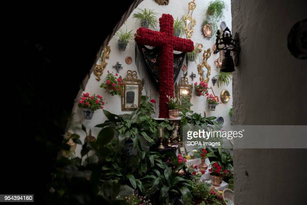An altar with a decorated cross in the terrace of Carmelitas Descalzas convent the day before Dia de la Cdruz or El día de la Cruz Día de las Cruces...