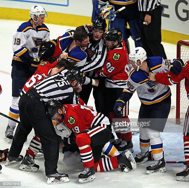 An altercation between the Chicago Blackhawks and the St Louis Blues breaks out at the end of the game after Game Four of the Western Conference...