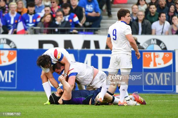 An altercation between Yoann Huget of France Louis Picamoles of France and Gary Graham of Scotland during the Guinness Six Nations match between...