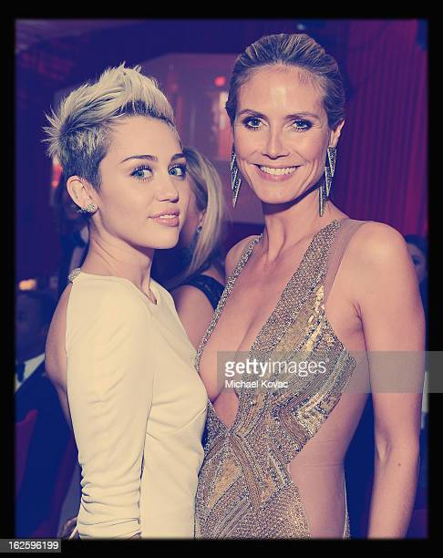 An alternate view of actress/singer Miley Cyrus and model Heidi Klum at the 21st Annual Elton John AIDS Foundation Academy Awards Viewing Party at...
