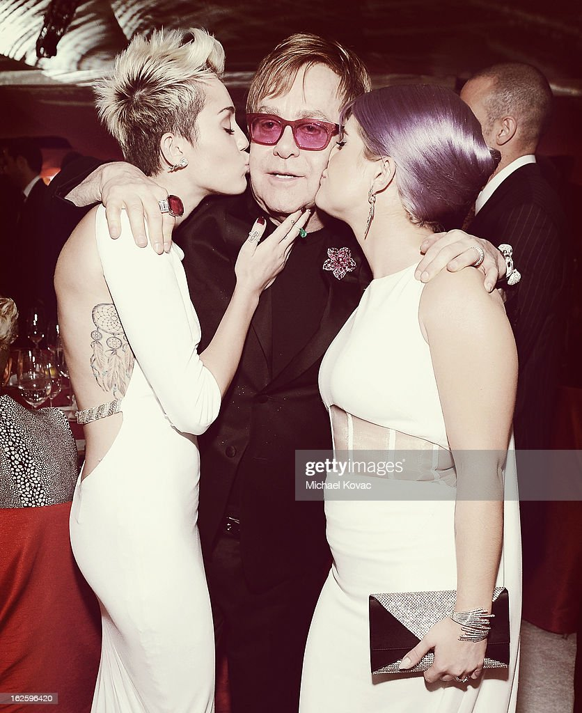An alternate view of actress/singer Miley Cyrus, Sir Elton John and tv personality Kelly Osbourne at the 21st Annual Elton John AIDS Foundation Academy Awards Viewing Party at West Hollywood Park on February 24, 2013 in West Hollywood, California.