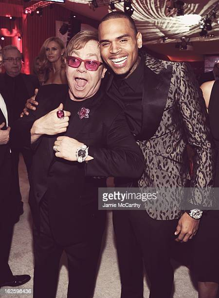 An alternate view of Sir Elton John and singer Chris Brown at the 21st Annual Elton John AIDS Foundation Academy Awards Viewing Party at West...