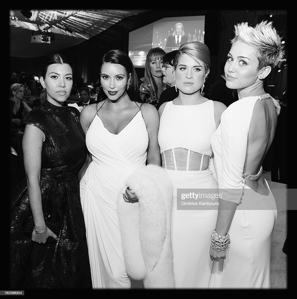 An alternate view of television personalities Kourtney Kardashian, Kim Kardashian and Kelly Osbourne and actress/singer Miley Cyrus at the 21st Annual Elton John AIDS Foundation Academy Awards Viewing Party at West Hollywood Park on February 24, 2013 in West Hollywood, California.